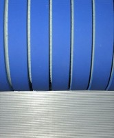 Dual Durometer Feed Roller and Horizontal Groove Pattern